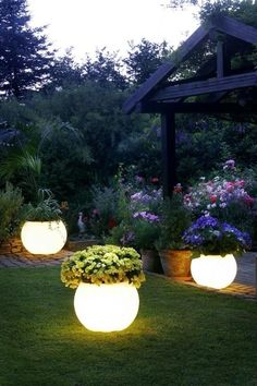 Garden planters painted with glow in the dark paint.  Wow