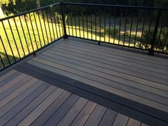 This beautiful deck has Timbertech's tigerwood decking with a mocha border and an aluminum Trex railing. It's hard to get photos to do it justice but you can see how the boards vary in color to give it more of a real hardwood appearance. This is a top of ...