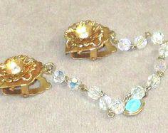 Sweater Clip goldtone iridescent rhinestone set in flower each clip