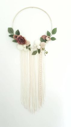 Boho Dreamcatcher - Custom To Order Make your wall beautiful with this soft and boho dreamcatcher! Perfect for any room! The base is a natural wood hoop made of artificial flowers and pom poms. The extensions are a variety of chunky wool, pompom trim and lace. Size guide: