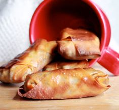Taco Egg Rolls: baked w ground beef, taco seasoning & cheese. Serve w sour cream or guacamole for dipping