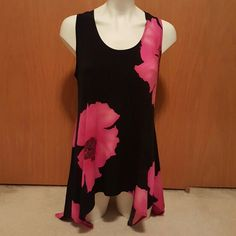 Black & pink sleeveless flower top This gem is NWOT...ladies large could fit XL also...never worn..smoke free home..how can u live,without this??!! :-) jostar Tops Blouses