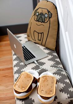 These are slippers that looks like s'mores. You plug them into your computer and they get WARM. WARM! | via Modcloth