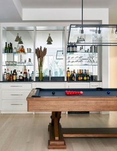 You might not have the space to dedicate an entire room to cocktails, but we've got some sharp ideas to help you connect with your inner mixologist and make a chic bar work in any setting. #hunkerhome #barideas #barcart #contemporarybarideas #chicbarideas Attic Renovation, Attic Remodel, Bar Billard, Pool Table Room, Pool Tables, Beach House Tour, Hamptons House, Apartment Therapy, Attic Design