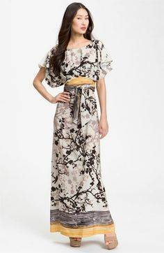 Black & grey maxi dress trimmed in butter yellow with flutter sleeves & an obi belt. Love the Japanese influence of style from the silouette to the pattern print.