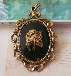 $20.00 Vintage Black and Gold Horse Pendant, Scroll Design, Big Pendant, Horse Jewelry, Cowgirl Jewelry, Equestrian Jewelry. $20.00, via Etsy. - I am absolutely positive that this falls under NEEEEEEEED
