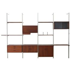 "Four-Bay Walnut ""Omni"" Shelving System by George Nelson, circa 1952 