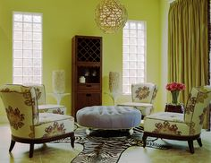 Designers Guild fabrics on custom chairs for an intimate seating arrangement for four.