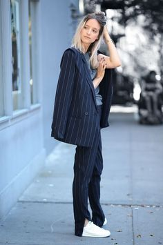30 outfits that prove pinstripes are back - pinstripe suit jacket + slouchy trousers with side slits, worn with white sneakers + graphic tee Athleisure Trend, Work Fashion, Fashion Looks, Fashion Outfits, 30 Outfits, Film Fashion, Suit Fashion, Sneakers Fashion, Fashion Ideas