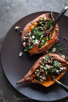 Baked sweet potatoes stuffed with feta, olives and sundried tomatoes. #healthy #recipe