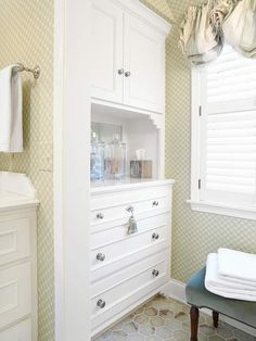 Linen Station- A built-in painted cabinet across from the toilet stores bathroom linens. The toilet and cabinet are tucked into ends of a small nook off the bathing and sink | http://coolbathroomdecorideas.blogspot.com