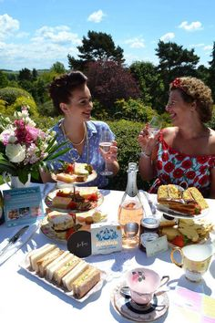 Afternoon Tea, Scones and Jam, Cakes, Vintage Tea party, Wine, Cups, Strawberries, Ladies, Flowers, Sunny day in the garden at the Dorothy Clive Garden in Staffordshire