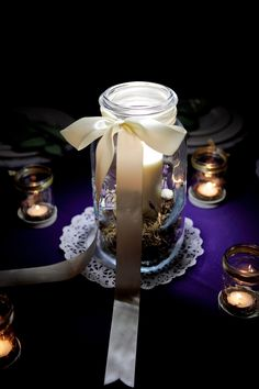 Photo by Krystle Akin- DIY Mason Jar Center pieces create beautiful lighting
