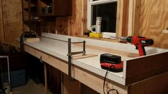 Up cycling an old counter top to make a long miter saw station with lots of storage.