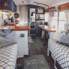 Image may contain: people sitting, bedroom and indoor via Camping has reinvented itself and has become more in. Bus Living, Tiny House Living, Bus Remodel, School Bus Tiny House, School Bus Conversion, Van Home, Tiny House Design, House On Wheels, Small Spaces