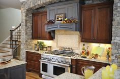 Pretty kitchen with rustic and contemporary elements and a stunning stone wall.