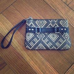 Express Black and Tan Woven Wristlet Black and tan woven wristlet with silver hardware, removable wristlet strap, 7 inches wide x 5 inches tall, like new, barely used Express Bags Clutches & Wristlets