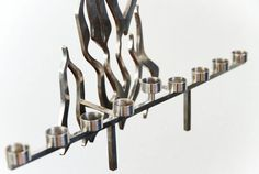 From SORTOFCHIC on Etsy, this amazing mid century menorah is an amazing piece of design history.