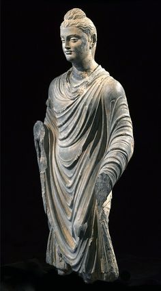 """MAGNIFICENT GANDHARAN STANDING BUDDHA, 1st-2nd century AD. Hands missing and repair at neck. 39"""" tall."""