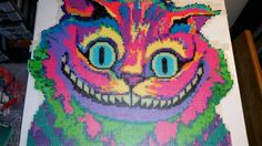 Psychedelic Cheshire Cat. The eyes and teeth glow in the dark. - Imgur