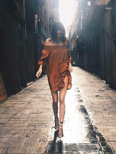 On Jenner:Mango Flowy Dress($70) in Mustard;Mangosandals. Similar Style: Aquazzura Amazon Lace-Up Leather Sandals ($695) in Black.