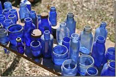Old blue glass bottles | Antique is best | Old ones of off odd shapes and sizes.