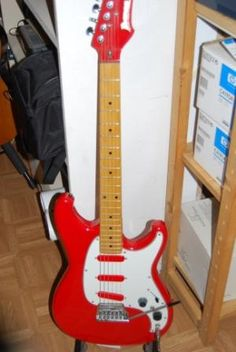 Ibanez Roadstar II.  My first was green.  I've got one in this red too, but the previous owner painted the pickguard gold.  I kinda like it.  Both need TLC.  I miss playing greeny.