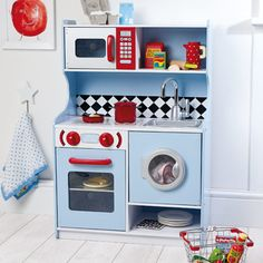 Bistro Kitchen -  this lovely little kitchen is appealing for boys too! With a little washing machine, oven and microwave it's the perfect miniature kitchen.