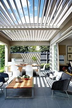 Aluminium adjustable louvers create a flexible outdoor living space that's usable all year round
