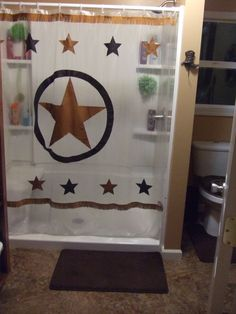 I wanted a western design, yet a clear shower curtain to let in light. Using double sided mounting tape I attached 2 rows of fringe and stars.