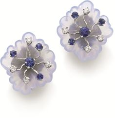 Seaman Schepps, A Pair of Blue Chalcedony, Sapphire and Diamond Earclips Each designed as a carved blue chalcedony flower, accented with circular-cut sapphires and diamonds, mounted in 18K white gold