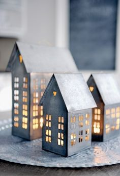 Rustic tin houses with lights as centerpiece or standalone Christmas decoration #europe