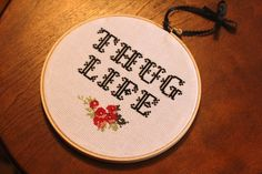 """FOR SALE  """"I didn't choose the thug life, the thug life chose me."""" ― Tupac Shakur  Please allow 1-2 weeks for your very own """"Thug Life"""" with flower detail hand-stitched embroidery to be completed.   7"""" wooden hoop"""