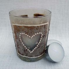 Round glass t-light holder covered in hand made paper and decorated with 3 hand painted / crafted recycled tea bags.