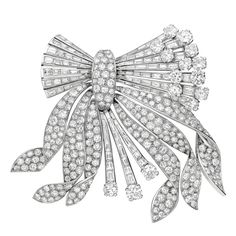 """1940's Diamond """"Flower Bouquet"""" Brooch , set with circular-cut and baguette-cut diamonds weighing approximately 26.00 total carats, mounted in platinum. $42,000"""