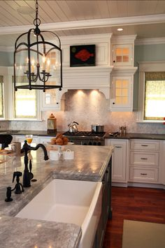 "Kitchen Ideas. Inspiring kitchen design ideas. Kitchen countertops are Soapstone in 1.25 thick material, island is Carrera 2 thick marble; both with ""Ogee edge treatment. The island is 156 x 56. Light fixture is the Arch Top Lantern from Visual Comfort. #Kitchen #KItchenIdeas #CountertopMaterial Asher Associates Architects."