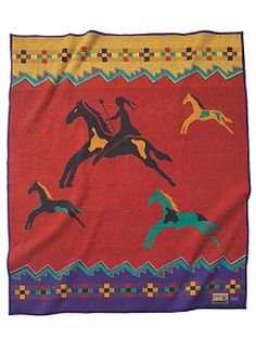 "Celebrate the Horse Blanket - A brave warrior astride a swift steed thunders across the plain. Similar images were painted on buffalo hides by Plains Indians in the 1800s. Our Celebrate the Horse blanket is based on a design from the Blackfoot tribe, expert horsemen who called the animal ""elk-horse"" for its great size. The arrival of the horse with 16th-century Spanish Conquistadors changed forever the culture of Native Americans, encouraging migration, trading, herding and hunting."