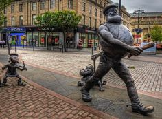 Desperate Dan struts across the mall in the centre of Dundee in Scotland.