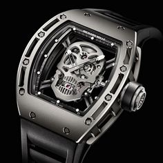 The luxury Tourbillon RM 052 Skull Watch by Richard Mille is limited to 21 pieces (15 in titanium, 6 made of white gold) and features one very obvious skull right in the center. Swiss made, skull in the dial, and machine run