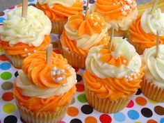 Maybe for a wedding cake we can do cupcakes. I want our high schools' colors (we went to rival schools). His are orange and brown (chocolate cake with orange frosting) & mine was blue and silver (white cake [my FAVORITE] with blue icing).