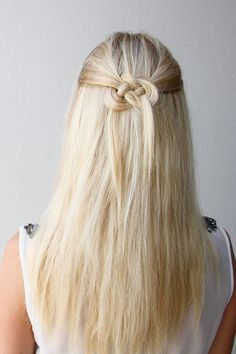 Why settle for pulling back your hair in a simple barrette when you could wow 'em with this cool Celtic knot? See how easy it is to create this half-updo hairstyle. - DivineCaroline.com