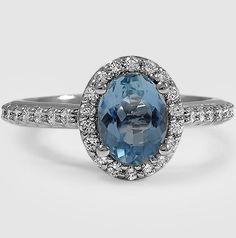 Platinum Sapphire Fancy Halo Diamond Ring With Side Stones set with 8x6mm Premium Oval Aquamarine.