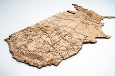Laser-cut wood veneer contour maps of US states - fiftyfourforty.com