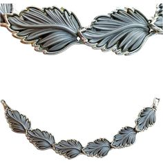 This 1960s bracelet with a decidedly mid century design is done with gray leaves set in silver tone metal. Minty!  Measurements: 7-1/2 inch end to