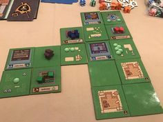 Here's a single player's town in a game we played. This particular player was doing pretty well, ready to sell a bunch of stuff to heroes. Tabletop Rpg, Single Player, Clash Of Clans, Cubes, Pixel Art, Board Games, Buildings, Purple, Pretty