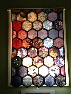 "That octagon window in the upstairs bathroom! (Hexagon ""stained glass"" curtain by Paisley Womble)"