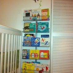 My solution for Elijah's board books....this way they face out like the rain gutter book shelves without all the work of making those. This is an elfa door and wall rack from The Container Store using the spice rack baskets.  So fast and easy and Elijah is already choosing a wider variety of stories :) #elfa @ContainerStore