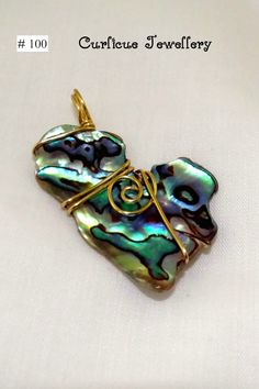 Gold wire wrapped paua shell pendant.(necklace not included). Made a beautiful #NZ-themed #Gift!