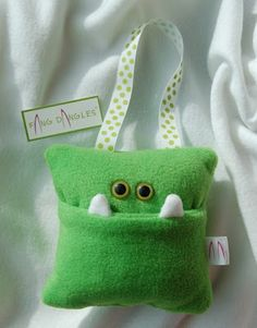 Idea only - monster tooth fairy pillow that hangs on bedpost or doorknob. Super cute.