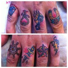 http://hunterandfoxtattoo.com/artwork/2432303_Finger_Symbols.html#
